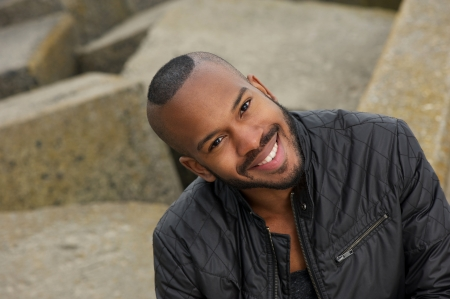 man face close up: Portrait of a happy young black man smiling outdoors