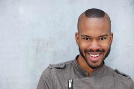 Portrait of a trendy young african american man smiling photo