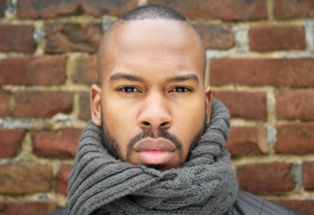 Close up portrait of a handsome african american man with scarf photo