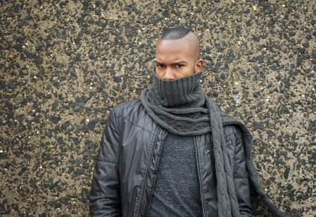 Portrait of a trendy african american fashion model with scarf covering face photo