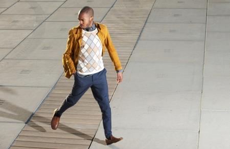 jacket: Portrait of a male fashion model walking outdoors Stock Photo