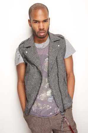 black fashion model: Portrait of a black fashion model posing against white wall