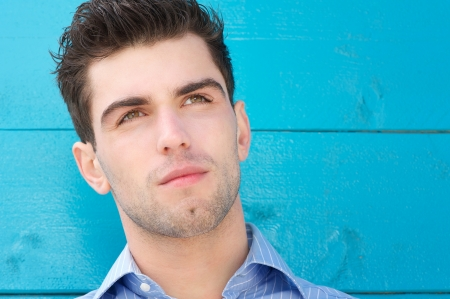 Close up portrait of a handsome young man with serious expression photo
