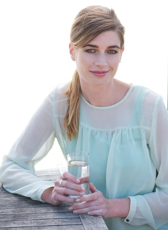 Portrait of a elegant woman enjoying a cool refreshing drink outdoors photo