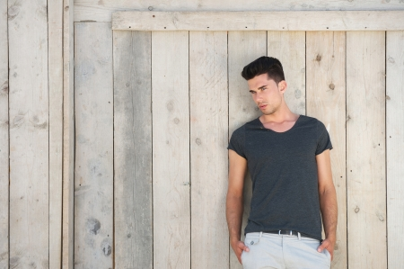 Portrait of a casual young man standing outdoors Standard-Bild