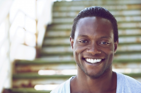 smile teeth: Closeup portrait of an african american man smiling outdoors Stock Photo