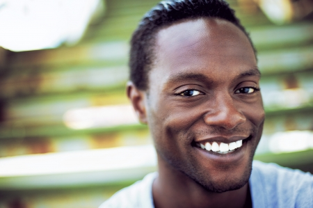Closeup portrait of an attractive african american man laughing  photo