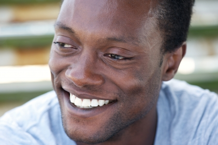 Closeup portrait of a happy african american man with a beautiful smile photo