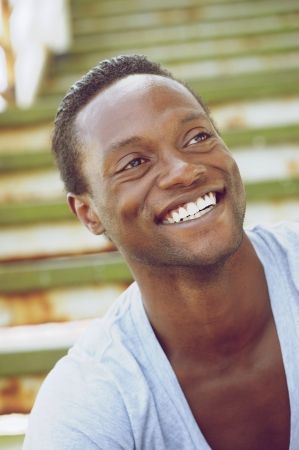Closeup portrait of an african american man laughing outdoors photo