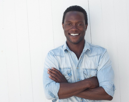 Closeup portrait of a handsome black man with arms crossed  photo