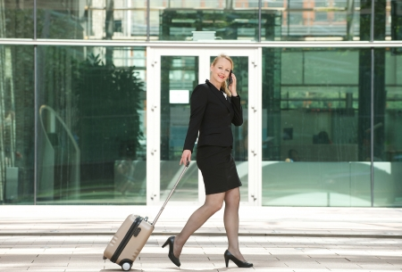 sidewalk talk: Portrait of a businesswoman traveling and calling with mobile phone Stock Photo