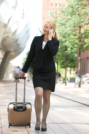 Portrait of a business woman calling on cellphone in the city Stock Photo - 21371531