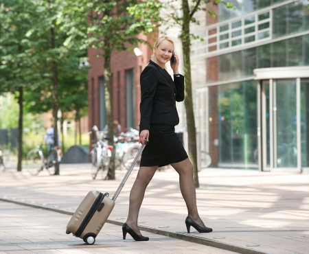 Portrait of a happy business woman talking on mobile phone in the city Stock Photo - 21371533
