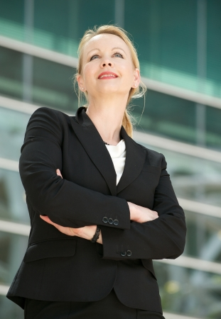 Closeup portrait of a businesswoman standing outside office building photo