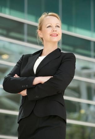 Portrait of a happy businesswoman smiling outdoors photo