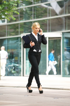 Portrait of a businesswoman talking on cellphone in the city photo
