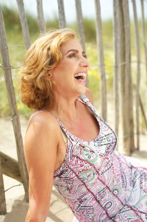 Closeup portrait of a happy woman laughing outdoors photo