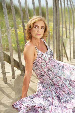 Portrait of a beautiful woman sitting outdoors photo