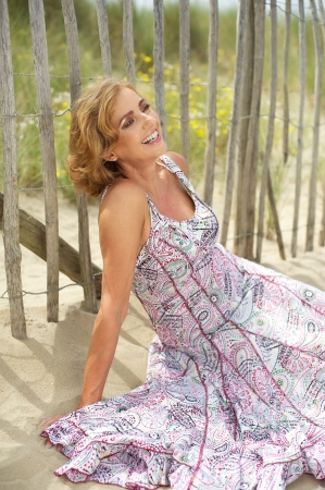 middle aged woman smiling: Closeup portrait of a beautiful middle aged woman smiling outdoors Stock Photo