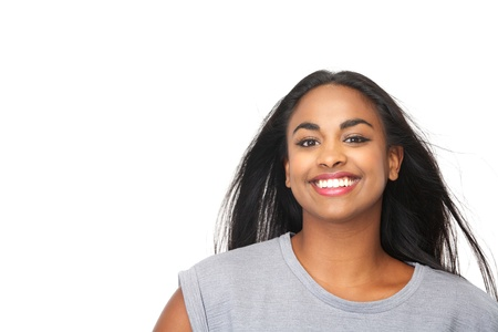 Closeup portrait of a beautiful black woman smiling in studio on isolated white background photo