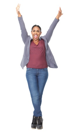 Full length portrait of a happy woman with arms raised photo