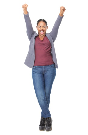 raised arms: Full length portrait of an attractive young woman with hands raised in celebration