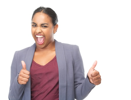 Closeup portrait of a successful young woman with thumbs up gesture photo
