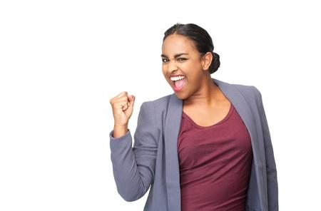 Close-up portret van een gelukkige jonge vrouw vieren met vuist pomp Stockfoto