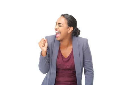 fist pump: Happy young woman celebrating with fist pump on isolated white background