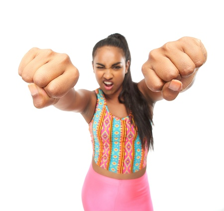 Closeup portrait of a young woman punching with two hands photo