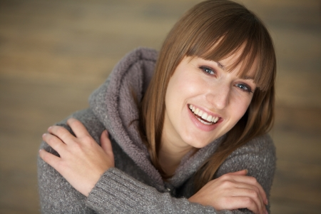 Closeup portrait of a beautiful young woman laughing photo