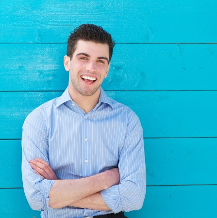 Closeup portrait of an attractive male model laughing outdoors Stock Photo