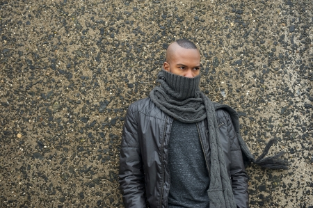Portrait of a male fashion model with scarf and leather jacket photo