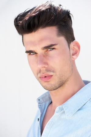 Closeup portrait of an attractive young male fashion model photo