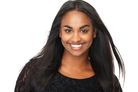 flowing hair: Closeup portrait of a beautiful young woman with long flowing hair, smiling on isolated white background