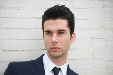 and the horizontal man: Closeup portrait of a handsome young man in business suit Stock Photo