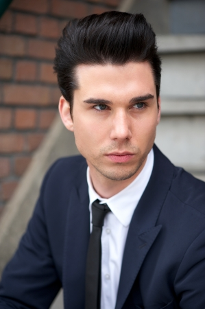 Portrait of a good looking male fashion model in suit photo