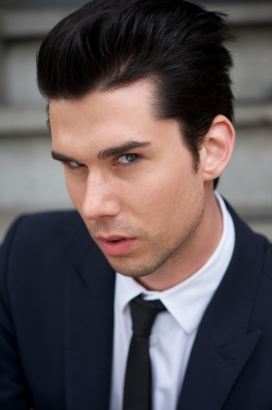 Closeup portrait of a handsome young man in suit and tie  photo