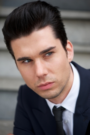 Closeup portrait of an attractive male business person photo