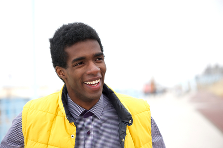 Horizontal portrait of a happy black man standing outdoors photo