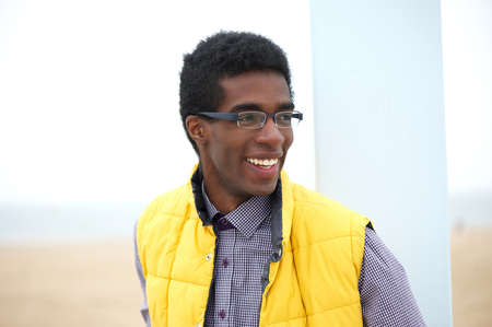 Portrait of an attractive young man wearing glasses outdoors photo