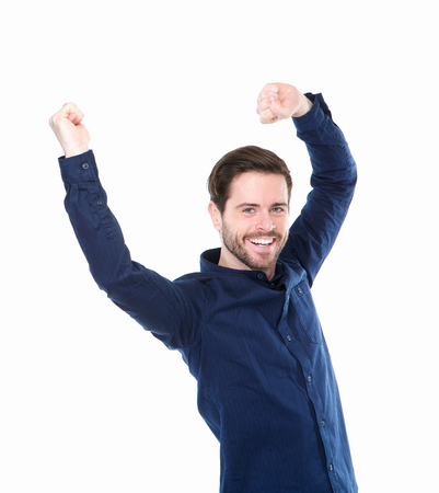 Portrait of a cheerful young man with arms raised in celebration photo