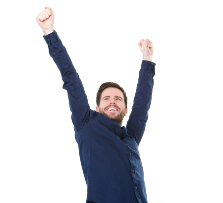 Portrait of a happy young man smiling with raised arms on isolated white background photo
