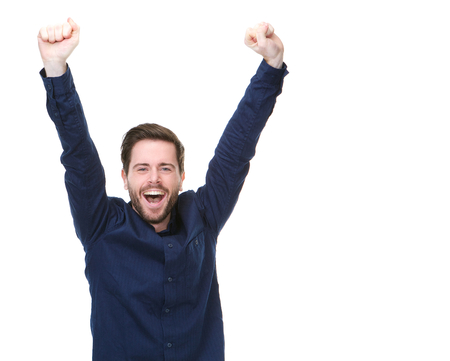 Portrait of a happy man smiling with arms raised on isolated white background photo