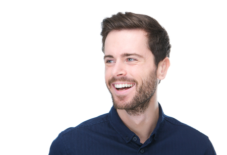 Closeup portrait of a handsome young man smiling on isolated white background