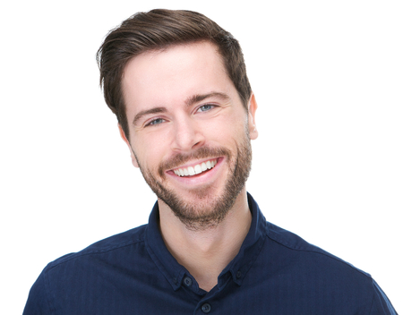 Closeup portrait of a happy young male model smiling on isolated white background photo