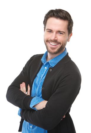 白い背景と分離笑みを浮かべて、魅力的な若い男の肖像