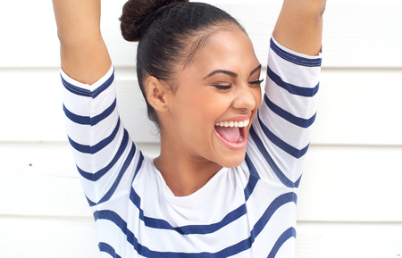 Closeup portrait of a happy latin american smiling with arms raised Stock Photo - 22399780