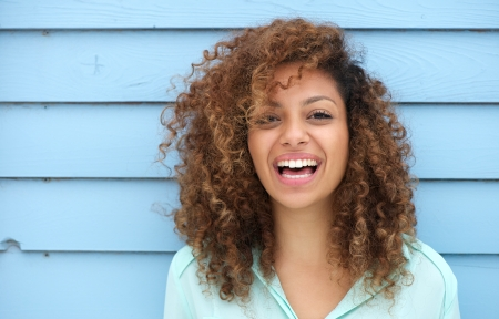 mixed race woman: Portrait of a cheerful young african woman smiling