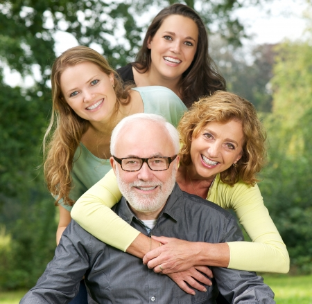 Closeup portrait of a happy family enjoying time together outdoors photo